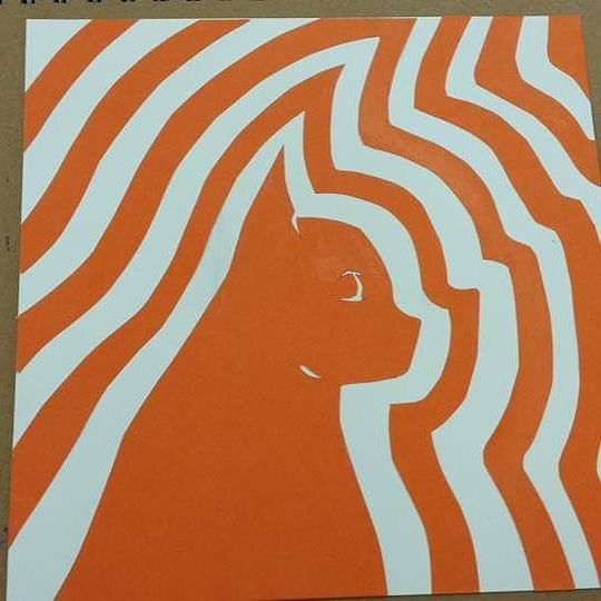 Orange cat art with lines radiating the shape of the solid cat figure going outward