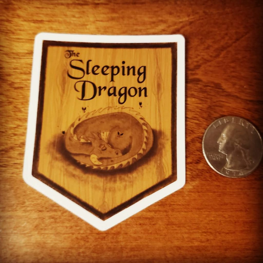 "Hardwood Sign design with a dragon curled up on it and the text ""the Sleeping dragon"""