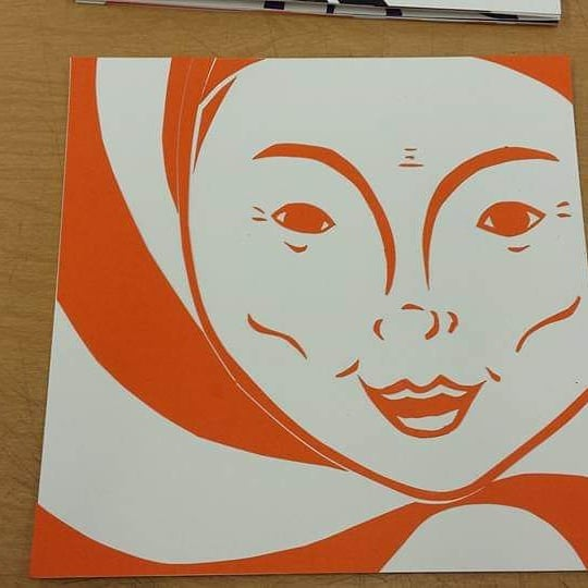 Woman created with basic orange linework with spirals in the background